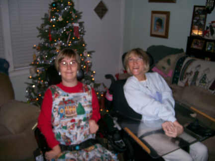 Brantley and Stacey with matching hair under the Christmas tree 12-3-10