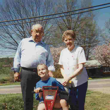 Grandmaw, Grandpa, and Brantley on Scooter 1998