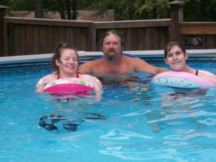 Mandy, Roy, and Brantley in the pool at Connie's 8-22-10